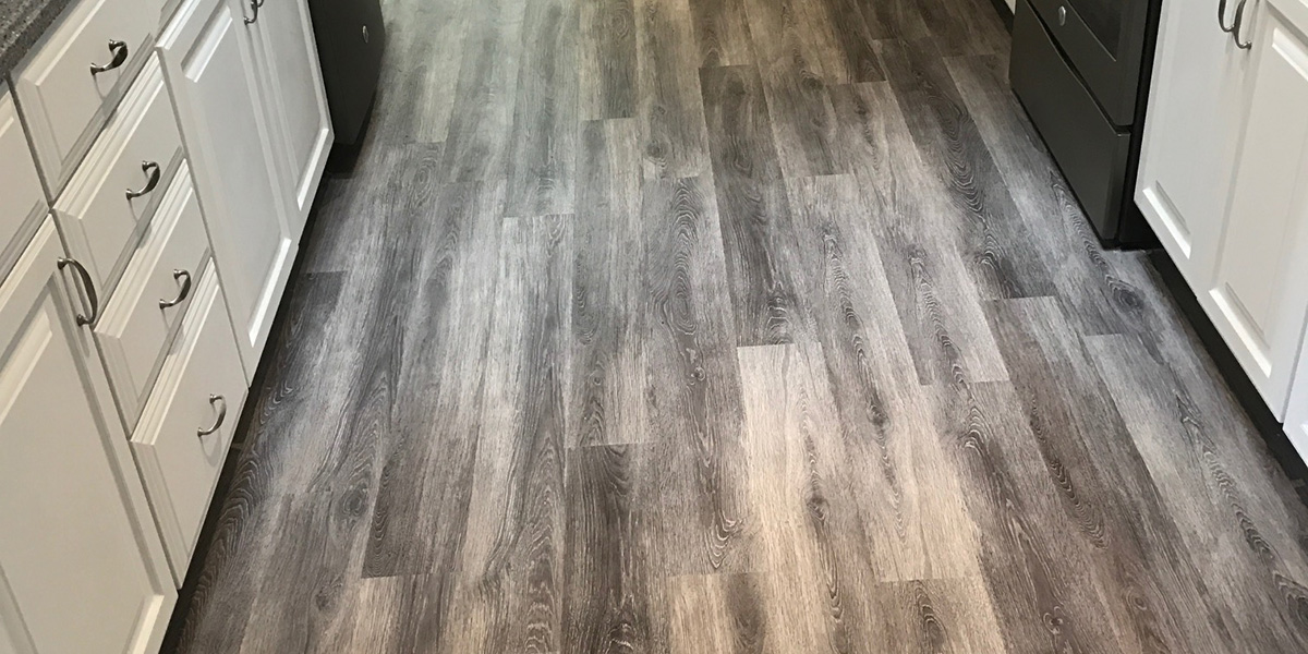 Grey Vinyl Plank In Galley Kitchen Hubs Flooring Inc